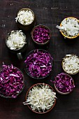 Bowls of sliced red and white cabbage