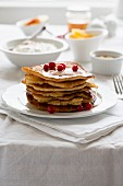 A stack of pancakes with redcurrants