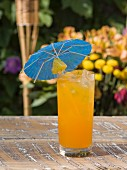 A refreshing fruit cocktail with a pineapple and a paper umbrella