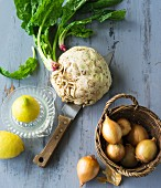 Detox food: a basket of onions, lemons, spinach and celery