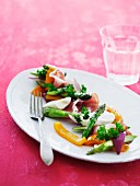 A platter of Parma ham, mozzarella and vegetables
