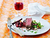 Beef steaks with cranberry sauce and Brussels sprouts