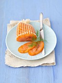 Smoked salmon in a net on a plate