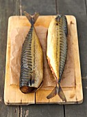 Smoked mackerel on a chopping board