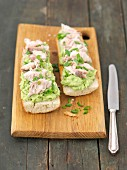 Baguette with guacamole and smoked mackerel