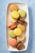 A dish of various pastel-coloured macaroons