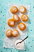 Sugared doughnuts on a doily