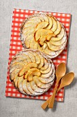 Apple tartlets with icing sugar