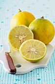 Bergamot fruits on a chopping board