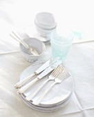 White crockery and glasses on a white tablecloth