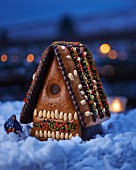 A gingerbread house with a little witch