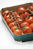Cherry tomatoes in a cardboard tray