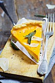 A slice of pumpkin quiche with sage and Parmesan cheese
