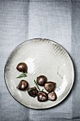Chestnuts and rosemary on a plate