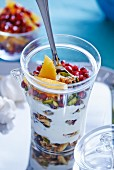 Granola with pomegranate, oranges and pistachios