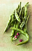 Runner beans, one opened