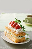 A puff pastry cake with strawberries and woodruff and quark cream