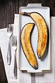 Caramelised bananas on a white platter