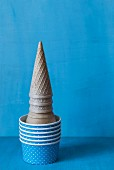 A stack of ice cream cones and paper cup