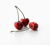 Three cherries with stalks