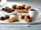 Coffee, muffins, jam and biscuits