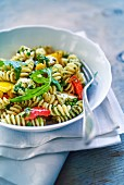Fusilli pasta with peppers, goat's cheese and rocket pesto