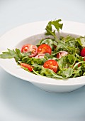 Tomato and rocket salad in a bowl