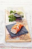 Salmon sashimi with soy sauce and lime