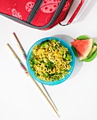 Ramen noodles with broccoli and pieces of watermelon for school