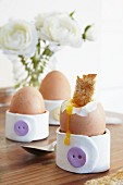 Egg cups hand-crafted from modelling compound