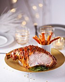 Christmas ham with cloves and rosemary, sliced
