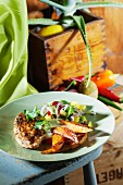 Grilled chicken breast with mango and red onion salsa and sweet potatoes