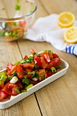 Fresh tomato salad with spring onions and a lemon dressing