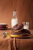 Chocolate doughnuts with milk and coffee