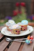 Spring cupcakes with berries and flower decorations