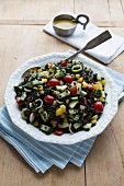 Beluga lentil salad with courgette, peppers, cherry tomatoes and vinaigrette