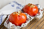 Stuffed grilled tomatoes with feta cheese in tin foil