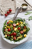 Mango and avocado salad with cherry tomatoes and rocket