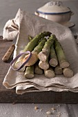 Green asparagus on a linen cloth