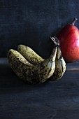 Old bananas with a pear