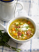 Vegetable soup with white beans, carrots, potatoes and Mettwurst