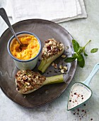 Fennel with a hazelnut filling served with carrot and potato mash