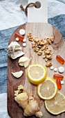 Lemon, ginger, garlic and tablets on a chopping board