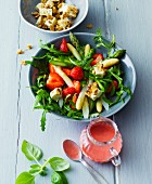Green and white asparagus salad with strawberries and walnut feta cheese