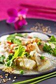 Halibut in coconut milk with peas and coriander