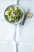 Artichoke and potato salad with rocket and egg