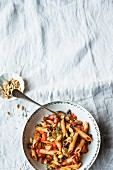 Penne with artichokes, tomatoes and pine nuts