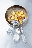 Fried potato in a pan