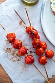 Roasted cherry tomatoes on wooden sticks