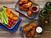 Chicken wings with dips and vegetables
